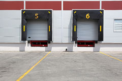 Dock doors. Two dock doors at warehouse for loading lorry Royalty Free Stock Photos
