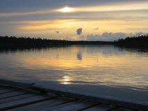 Dock at dusk. Fishing camp at dusk Royalty Free Stock Photography