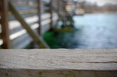 Dock. Extreme close-up of the wooden railing along a dock stock photos