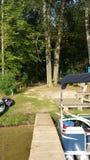 Dock facing the trees Stock Photos