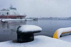 Dock with the ferry at the port of winter blizzard Royalty Free Stock Images