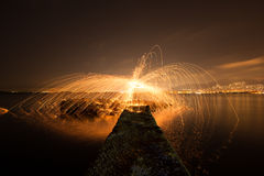 Dock is on fire. A mushroom of fire, using steel wool on a dock Royalty Free Stock Image