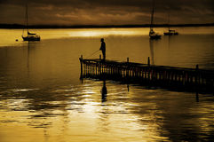 Dock and Fisherman Stock Photo