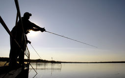 Dock Fishing. Two men fishing off a dock at a lake Stock Photo