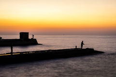 Dock Fishing at Sunset Stock Photography