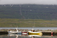 Dock with fishing-trawlers in Iceland Stock Images