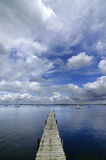Dock Floating in Blue Water Royalty Free Stock Images
