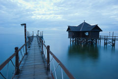 Dock and floating hut Stock Images