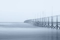 Dock in the fog Stock Images