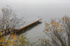 Dock on foggy day. Royalty Free Stock Images