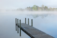 Dock on Foggy Lake royalty free stock images