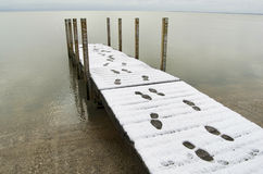 Dock With Footprints In Snow Stock Photos