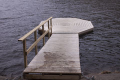 Dock in the forrest. At a lake Stock Images