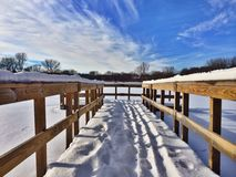 Dock on a frozen lake stock images