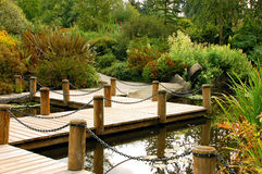 Dock on garden pond. In late summer royalty free stock images