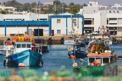 Dock, harbour, pier, with boats in water and land, Lagos, Portugal stock photo