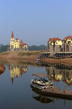 Dock and homes or houses. A row of new homes is by a lake royalty free stock photography