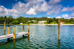 Dock and houses along Collins Canal in Miami Beach, Florida. Royalty Free Stock Photography