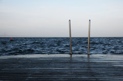 Dock and Ladder. With the Oresund bridge in the far distance Royalty Free Stock Image
