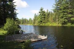 Dock On The Lake. Small dock on lake Stock Photos