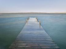 Dock in a Lake. Wooden dock in a lake. Photo taken using a long time of exposure Royalty Free Stock Image