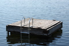Dock on lake. Empty dock on lake used for swimming and diving Royalty Free Stock Photo