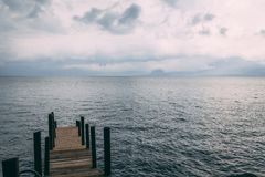 Dock on lake atitlan in guatemala stock photography