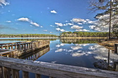 Dock on a lake HDR. Royalty Free Stock Photography