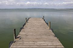 A Dock By The Lake At morning Sky stock photo