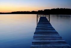 Dock on the lake shore Stock Photos