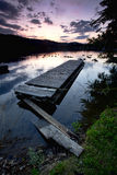 Dock on lake at sunset. Royalty Free Stock Photos