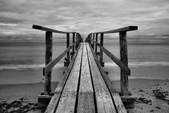 Dock. Landscape featuring a beach with a dock royalty free stock photos