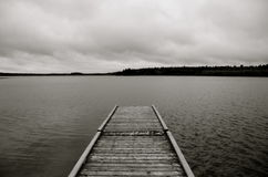 Dock, Laurie Lake, Duck Mountain Provincial Park, Manitoba, Canada. Dock on a cloudy day on Laurie Lake, Duck Mountain Provincial Park, Manitoba, Canada, Black Royalty Free Stock Images