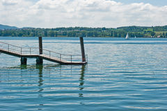 Dock leading to lake Royalty Free Stock Photos