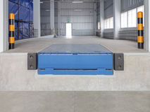 Dock. Leveler machine use for product transfer  to truck Royalty Free Stock Photography