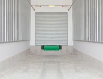 Dock leveler. And shutter door outside factory Royalty Free Stock Photo