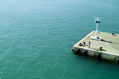 Dock and lighthouse. In Split harbour in Croatia stock photo