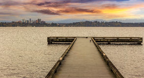 The Dock at Madrona Beach. On Washington Lake in Seattle during sunset Stock Photos