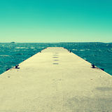 Dock in the Mediterranean sea, with a retro effect Royalty Free Stock Images