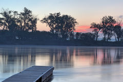 Dock on the Missouri River. Sunrise picture of the Missouri river in Bellevue Nebraska stock image