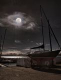 Dock at night. With moon Stock Photos