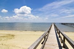 Dock, ocean, and clouds Royalty Free Stock Photo