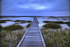 Dock over salt marsh. At night, hdr image Royalty Free Stock Photo