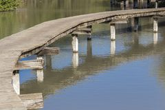 Dock over water. Dock made of wood over a swamp in Afek nature reservation - Israel Stock Images