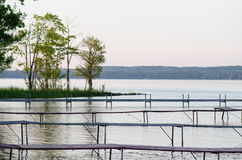 Docks on a Peaceful Lake Stock Images