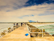 The dock. Photo taken in Florida last winter. There was a peculiar light and one sees in the distance the lighthouse of Ponce Islet, Florida Royalty Free Stock Photo