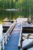 Dock or pier on lake in summer day. forest,  Finland Stock Photo