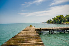 Dock pier in livingston guatemala. Wooden dock pier overlooking sea in livingston guatemala Stock Images