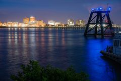 Dock Pilings Shine Blue Mississippi River Flowing By Baton Rouge stock photo