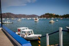 Dock at PLaya la Ropa. IXTAPA, ZIHUATANEJO/MEXICO -  JUN, 13, 2013: PLaya la Ropa were several water taxis are ready Royalty Free Stock Images